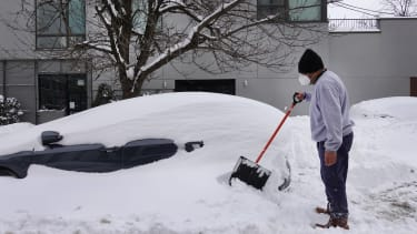 Digging a car out of the snow