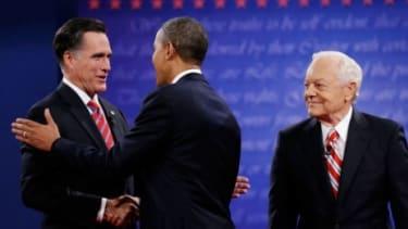 Mitt Romney greets President Obama at the final presidential debate.