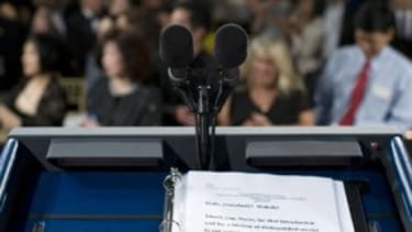 Behind the podium