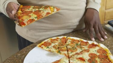 The average American consumed 31.4 pounds of cheese and 53 gallons of soda last year.