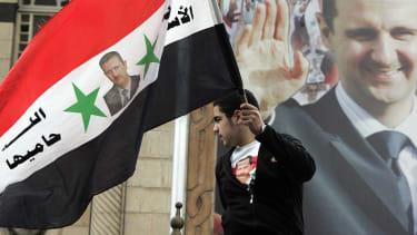Syrian boy holding flag.