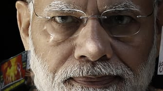 India Prime Minister Narendra Modi and protesters