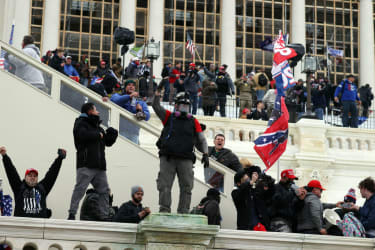 Trump supporters attacking the Capitol.