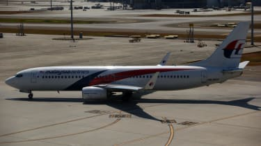 Malaysia Airlines Flight 370 families get $50,000 in first payouts