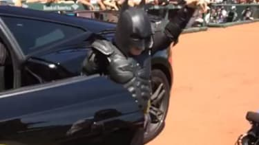 Batkid cruises up in a Ferrari to throw the first pitch at a San Francisco Giants game