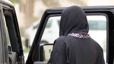 A Saudi woman gets into a car in Riyadh, Saudi Arabia.