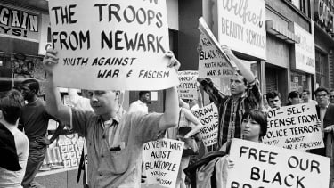 Picketers calling for the removal of National Guard troops