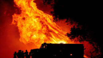 Flames shoot up near firefighters in Northern California.