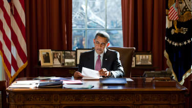 President Obama sits in the Oval Office.