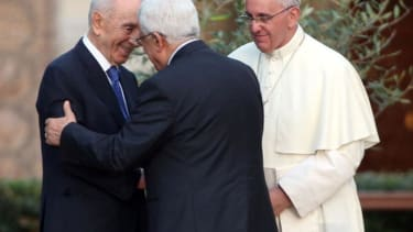 Pope Francis gets the Israeli and Palestinian presidents to hug, pray together