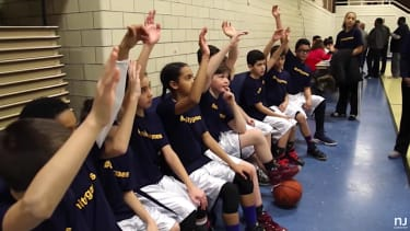 The St. Johns basketball team votes to keep the girls, forfeit the season