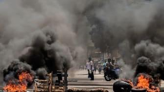Barricades on fire in Valencia, Venezuela.