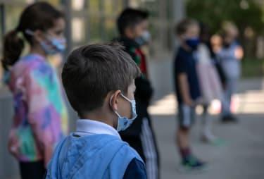 Children wear masks.