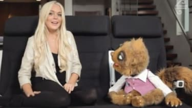 In this promo for Air New Zealand, Lindsay Lohan fields questions (from a puppet) about travel, legal woes, and celebrity friends.