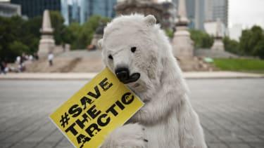 A Greenpeace activist in a polar bear suit