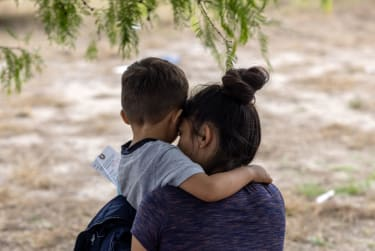 Mother and son migrants from El Salvador.