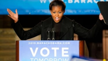 Michelle Obama speaks at a rally aimed at young voters. A Gallup poll found 75 percent of Republicans were 'certain' to vote, compared to 68 percent of Democrats.