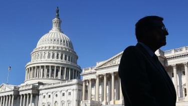 Senator standing outside of U.S. Capitol.