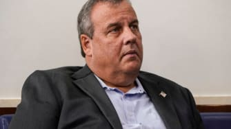 Former New Jersey Governor Chris Christie listens as U.S. President Donald Trump speaks during a news conference in the Briefing Room of the White House on September 27, 2020 in Washington, D