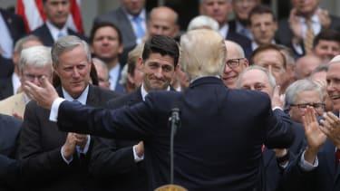 President Trump goes in to hug Paul Ryan.