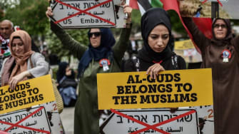Women protestors hold placards reading 'Al Quds belongs to muslims' on May 11, 2018 in Istanbul, during a demonstration against US President Donald Trumps controversial decision to recognise