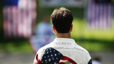 A man shows his patriotism at a Tea Party meeting in Illinois