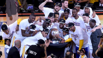 The Golden State Warriors celebrate their win over the Houston Rockets on May 27, 2015