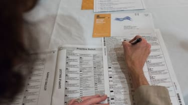 Filling out a mail-in ballot.