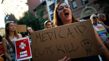 A small group of activists rally against the GOP health care plan outside of the Metropolitan Republican Club, July 5, 2017 in New York City.