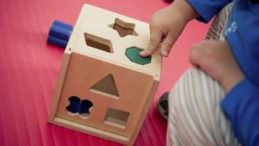Kid solving puzzle