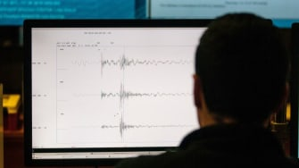 A person looks at a seismograph.