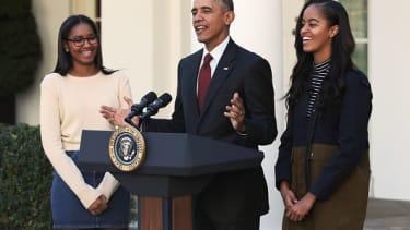 Sasha Obama, President Obama, and Malia Obama.