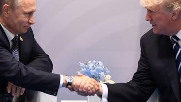 Putin and Trump meet.