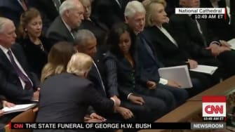 Trump and the Obamas.