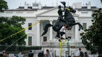 Protesters try to pull down a statue of Andrew Jackson.