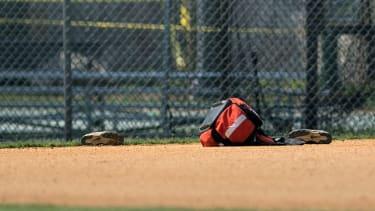 Baseball gear left on field at scene of shooting.