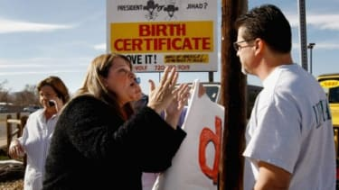 Even if the truth is out there, our emotional attachment to our beliefs may prevent us from seeing it. Here, an Obama supporter argues with a woman demanding to see the president's birth cert
