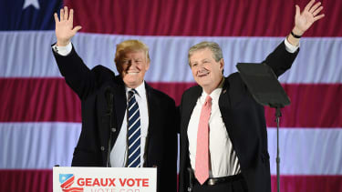 US President-elect Donald Trump (L) and Louisiana Treasurer and Republican Senate candidate John Kennedy wave at a get-out-the-vote rally on December 9, 2016 in Baton Rouge, Louisiana