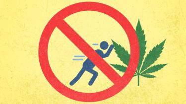 A marijuana leaf being pushed.