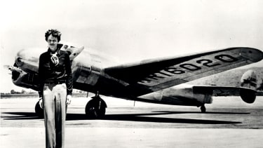 Amelia Earhart standing in front of the Lockheed Electra in which she disappeared in July 1937