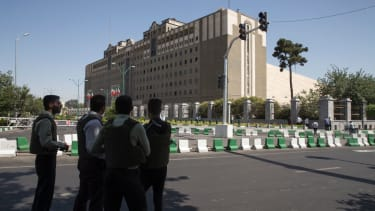 Police officers outside of Iran's parliament building.