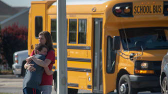A student and adult embrace outside Noblesville West Middle School after a shooting at the school on May 25, 2018 in Noblesville, Indiana.