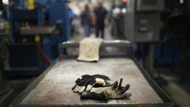 A glove is left behind on a factory table.