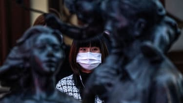 A woman wears a face mask