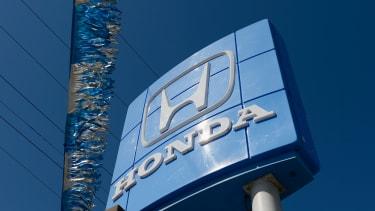 The Honda logo at a dealership