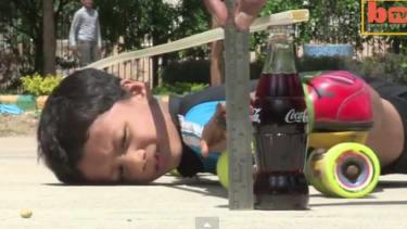Daredevil 6-year-old rollerskates under 39 cars