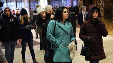Tourists visit the lobby of Trump Tower.