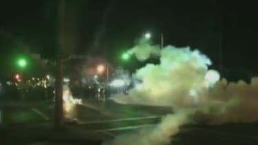 Watch Ferguson police bombard fleeing protesters with tear gas