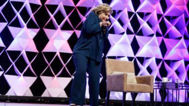 Watch Hillary Clinton dodge a flying shoe
