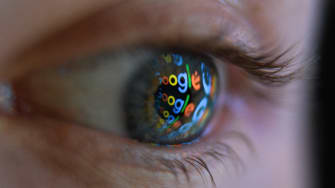The Google logo reflected in person's eye.